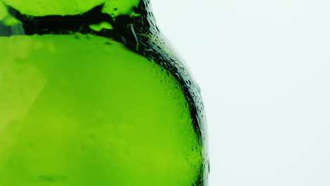 Part-Of-The-Glass-Beverage-Bottle-Drops-Of-Condensate-Drain-Down-On-A-White-Background-Cool-Drinks-C