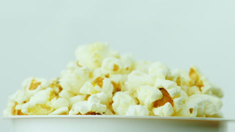 A-Glass-Of-Popcorn-On-A-White-Background-Slowly-Rotates-4K-Video