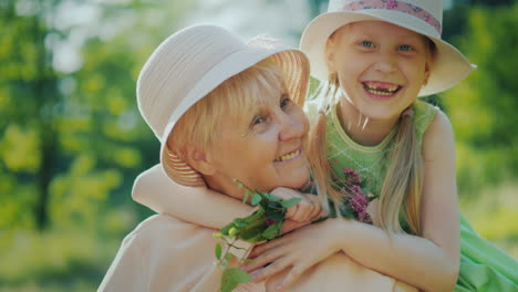 The-Carefree-Girl-Runs-To-Her-Grandmother-And-Embraces-Her-Emotionally-Granddaughter-And-Grandmother