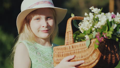 Portrait-Of-A-Fair-Haired-Girl-Of-Seven-Years-With-A-Basket-Of-Wildflowers-4K-Video