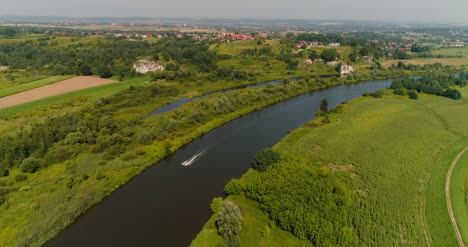 Aerial-View-Of-Motorboat-Swimming-In-River