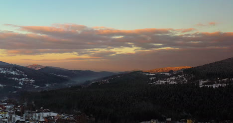 Vista-Aérea-View-Of-Mountains-And-Forest-Covered-With-Snow-At-Sunset-In-Winter-8