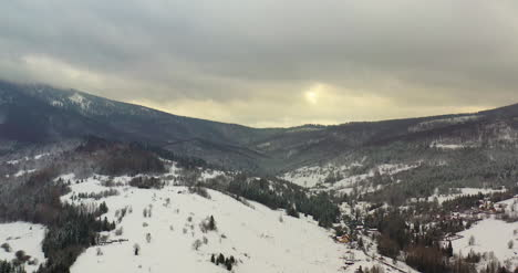 Forest-Covered-With-Snow-Aerial-View-Aerial-View-Of-Village-In-Mountains-6