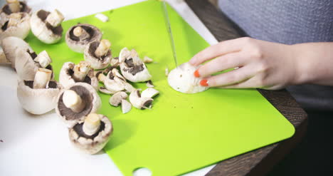 Cuting-Slicing-Mushrooms-In-The-Kitchen-For-Cooking-1