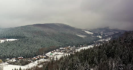 Forest-Covered-With-Snow-Aerial-View-Aerial-View-Of-Village-In-Mountains-8