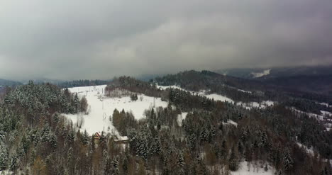 Forest-Covered-With-Snow-Aerial-View-Aerial-View-Of-Village-In-Mountains-9