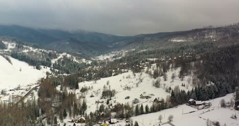 Forest-Covered-With-Snow-Aerial-View-Aerial-View-Of-Village-In-Mountains-13