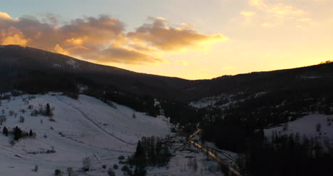 Sunset-At-Mountains-In-Winter-Aerial-View-3