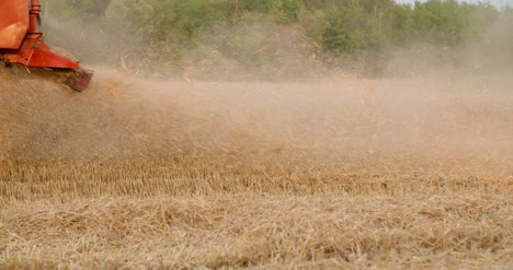 Combine-Harvester-Harvesting-Agricultural-Wheat-Field-2