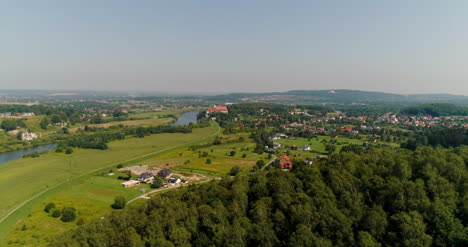 Aerial-View-Of-Landscape-And-Small-City-Agains-Mountains-2