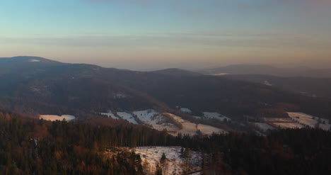 Aerial-View-Of-Woods-And-Mountains-In-Winter-4