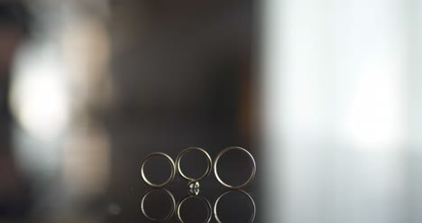Close-Up-Of-Wedding-Rings-On-Table-1