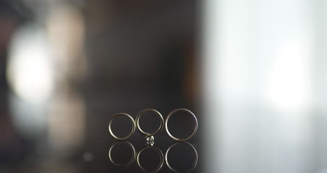 Close-Up-Of-Wedding-Rings-On-Table-2