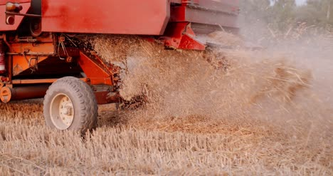 Close-Up-Of-Combine-Harvester-On-Field-At-Farm-11