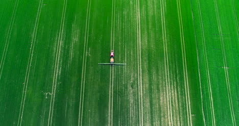 Agriculture-Aerial-Of-Farmer-Spraying-Farm-Land-With-Pesticides-2