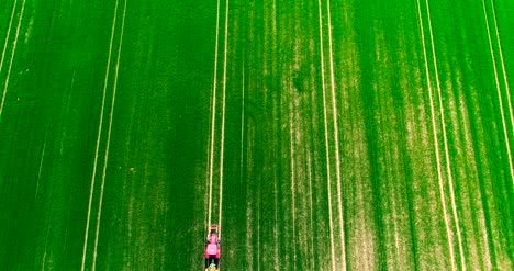 Agriculture-Aerial-Of-Tractor-Spraying-Farm-Land-With-Pesticide-3