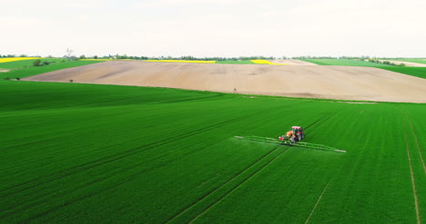 Agriculture-Aerial-Of-Tractor-Spraying-Farm-Land-With-Pesticide-6