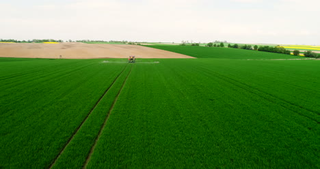 Agriculture-Aerial-Of-Tractor-Spraying-Farm-Land-With-Pesticide-7