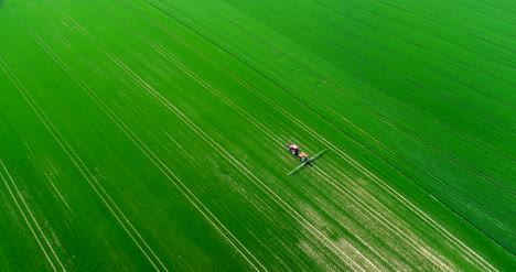 Agriculture-Aerial-Of-Tractor-Spraying-Farm-Land-With-Pesticide-9