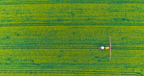 Agriculture-Aerial-Of-Tractor-Spraying-Farm-Land-With-Pesticide-11