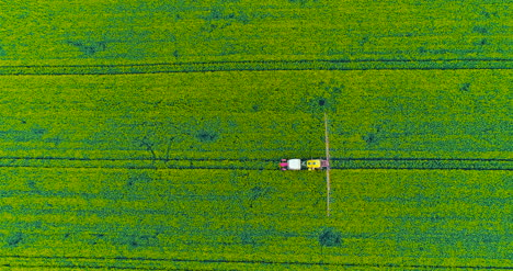 Agriculture-Aerial-Of-Tractor-Spraying-Farm-Land-With-Pesticide-12