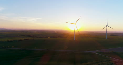 Aerial-View-Of-Windmills-Farm-Power-Energy-Production-8