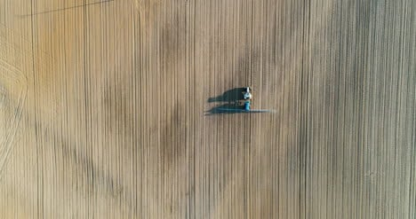 Agricultural-Tractor-Working-In-Field-Aerial-View-