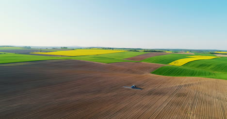 Gmo-Food-Production-Tractor-Spraying-Field-With-Chemicals-