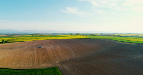 Aerial-Shoot-Of-Tractor-Working-On-Field-Agriculture-