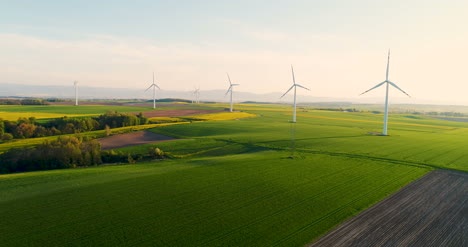 Agriculture-Aerial-View-Of-Summer-Countryside-With-Wind-Turbines