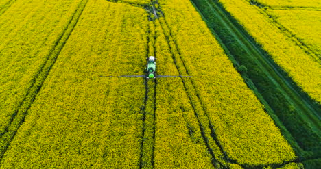 Farmer-Spraying-Field-With-Pesticides-Agriculture-Aerial-