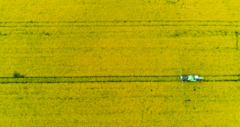 Agriculture-Aerial-Of-Tractor-Spraying-Farm-Land-With-Pesticides-2