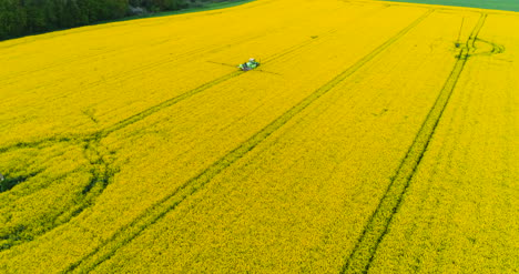 Agriculture-Aerial-Of-Tractor-Spraying-Field-With-Pesticides