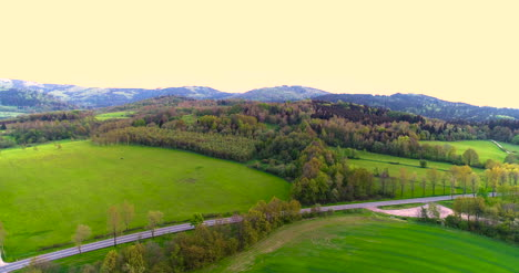 Stunning-Aerial-Shot-Over-Lush-Green-Fields-And-Meadows-In-The-Countryside-