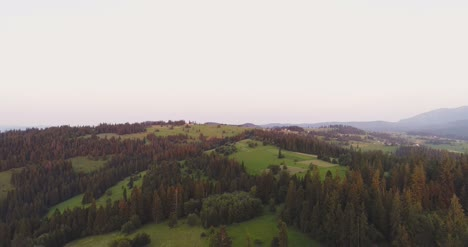 Scenic-Agricultural-Field-And-Forest-Against-Sky-1