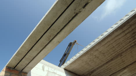The-Boom-Of-The-Crane-Installs-A-Heavy-Reinforced-Concrete-Panel-For-The-Floor-Construction-Of-House