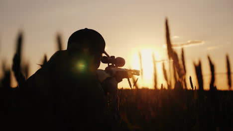 A-Sniper-Rifles-From-A-Rifle-With-An-Optical-Sight-On-The-Sunset-Sports-Shooting-And-Hunting-Concept