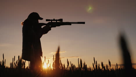 The-Hunter-Is-Aiming-From-A-Rifle-With-An-Optical-Sight-It-Stands-In-A-Picturesque-Place-At-Sunset-4
