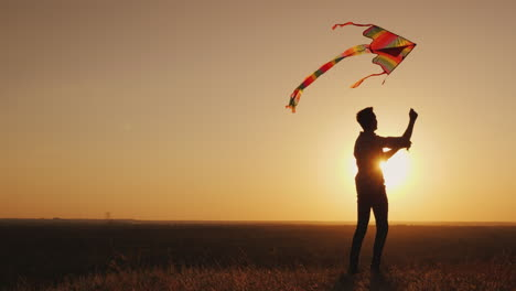 A-Teenager-Launches-A-Kite-At-Sunset-4K-Video