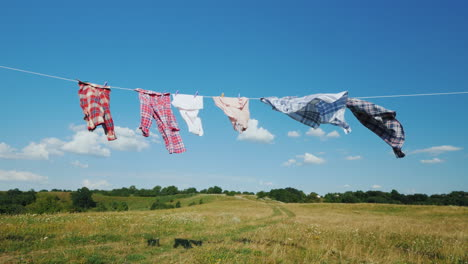The-Linen-Dries-On-A-Rope-In-A-Clean-Picturesque-Place-In-The-Background-Is-A-Rural-Landscape