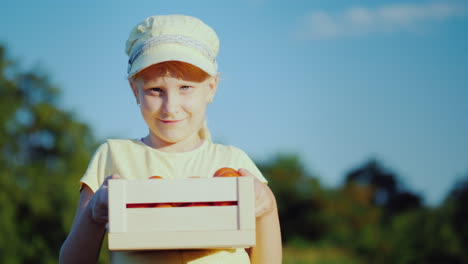 Portrait-Of-A-Child-Farmer-The-Girl-Is-Standing-On-The-Field-Holding-A-Small-Box-With-Tomatoes-4K-Vi