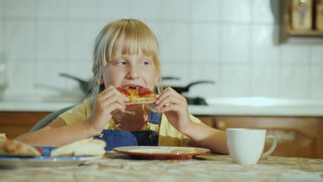 A-Little-Girl-With-An-Appetite-Eating-Pizza-In-The-Kitchen-4K-Video
