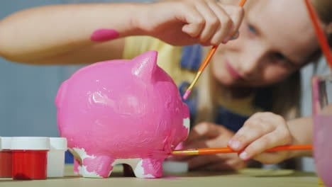 Children-Cheerfully-Paint-Piggy-Bank-Happy-Childhood-Concept-4K-Video