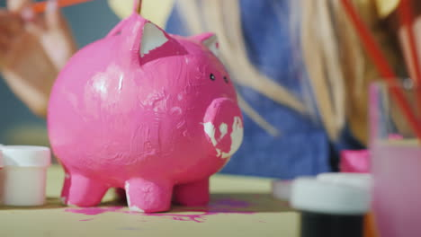 Children-Together-Paint-A-Piggy-Bank-In-Pink-Games-With-Children-Concept-4K-Video