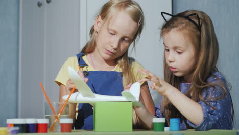 Two-Children-Together-Paint-The-Model-Of-The-Aircraft-Developmental-Games-For-Children-4K-Video