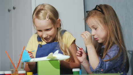 Two-Children-Together-Paint-A-Model-Of-A-Somet-With-Watercolors-Lessons-For-The-Development-Of-Child