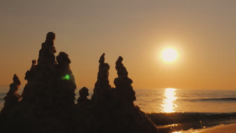 A-Sand-Castle-By-The-Sea-At-Sunset-4K-Video