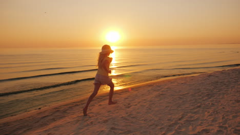 Carefree-Barefooted-Child-Runs-Happily-Along-The-Edge-Of-The-Water-By-The-Sea-At-Sunset-4K-Video