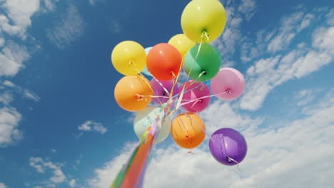 Many-Multi-Colored-Balloons-Aspire-To-The-Sky