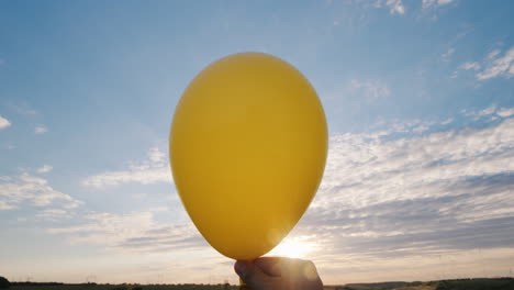 Air-Comes-From-The-Red-Air-Balloon-And-It-Becomes-Limp-Against-The-Background-Of-The-Blue-Sky